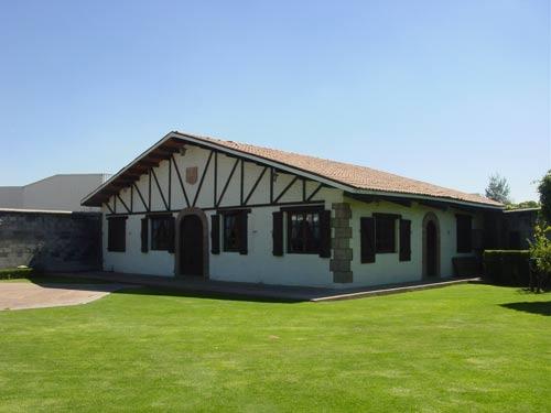 Headquarters of the Celaya Basque association, that includes the Basque farm style building, a green area and gardens, and a Basque handball or pelota court (photo EuskalKultura.com)