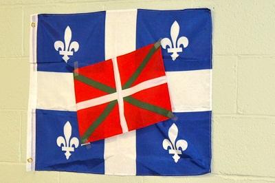 Quebec's flag with the Ikurrina at Euskaldunak of Quebec's Aberri Eguna festivities (photo QuebecEE)