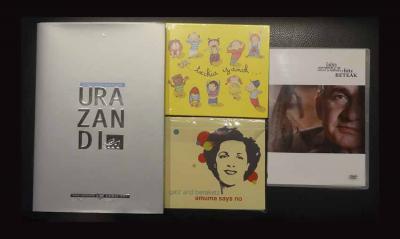 Zozketagai dira irudiko liburua, bi CDak, DVDa eta bisita gidatu bat Donostiara